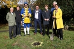Wealden MP Nus Ghani (right) with: Cllr. Paul Sparks; Cllr. Daniel Manville; Town Crier Ian Bedwell; The Mayor of Uckfield, Cllr. Spike Mayhew; Cllr Claire Dowling; and, Cllr Bob Standley from Wealden District Council. They were planting trees as part of The Queen's Canopy Scheme.